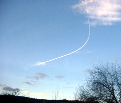 [Photograph of plane turning]
