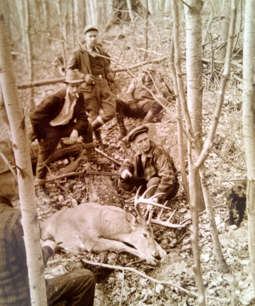 My grandfather's hunting party with their prize.