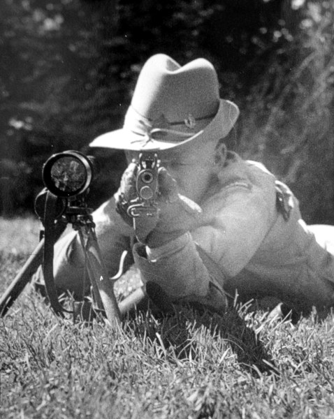 Donald Smith Fraser with his rifle and telescope.