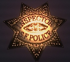 [Inspector S.F. Police badge]