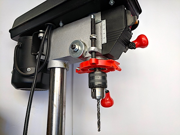 [Drill press with plastic depth stop]