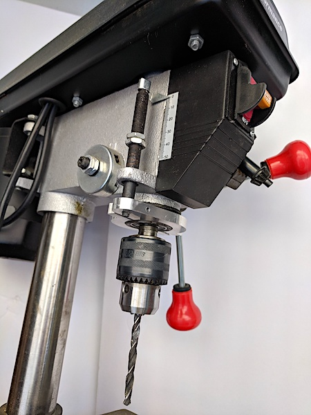 [Drill press with aluminum depth stop]